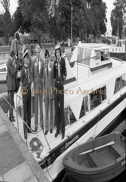 Irish Scout Jamboree .at Portumna Co Galway.1985..31.07.1985.07.31.1985.31st July 1985..The President Dr Patrick Hillery officially opened The Irish Scout Jamboree. The President,who arrived by helicoptor,was greeted by Camp Chief, Michael Webb, and a guard of honour of senior scouts. Amoung the invited guests from church and State was Mr Nicholas Scott,the Northern Ireland Office, Minister for Education..Ten thousand scouts took part in the jamboree. The Jamboree was a first in that for the first time the three scouting organisations within Ireland came together. The Scout Association of Ireland,The Catholic Boy Scouts of Ireland and The Northern Ireland Scout Council..Pictured aboard an Emerald Star Cruiser were Mr Eoghan Lavelle,Chief Scout,Scout Association of Ireland, Mr Nicholas Scott, Northern Ireland Minister for Education, Mr George Bermingham TD,Dept of Labour with responsibility for Youth Affairs and a member of the Sea Scouts, Alan Reynolds From Dollymount in Dublin.