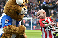 Charlie Proctor, who lead the teams out, high fives during the EFL Sky Bet Championship match between Blackburn Rovers and Aston Villa at Ewood Park, Blackburn, England on 29 April 2017. Photo by Mark Pollitt.