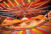 Oct. 21, 2009 -- PHOENIX, AZ: A ride on the midway at the Arizona State Fair in Phoenix, AZ. The fair runs through November 8.   Photo by Jack Kurtz