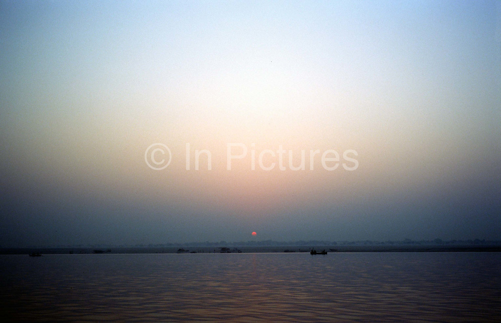 Sunrise over the Ganges at Varanasi, India