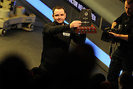Stephen Maguire of Scotland celebrates his win as he lifts the trophy. The Final, Stephen Maguire of Scotland v Stuart Bingham of England. Welsh open snooker 2013, Newport centre in Newport, South Wales on Sunday 17th Feb 2013. pic by Andrew Orchard, Andrew Orchard sports photography,