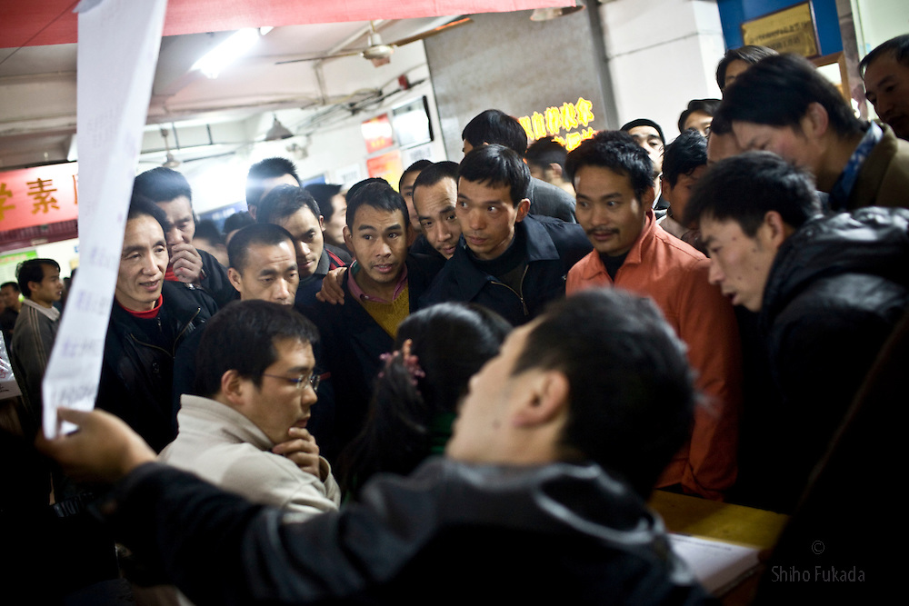 Migrant workers look for jobs at Nanjimen Labor Market in Chongqing, China, March 3, 2009.