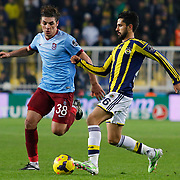 Fenerbahce's Alper Potuk (R) and Trabzonspor's Salih Dursun (L) during their Turkish superleague soccer derby Fenerbahce between Trabzonspor at the Sukru Saracaoglu stadium in Istanbul Turkey on Saturday 07 February 2015. Photo by Aykut AKICI/TURKPIX