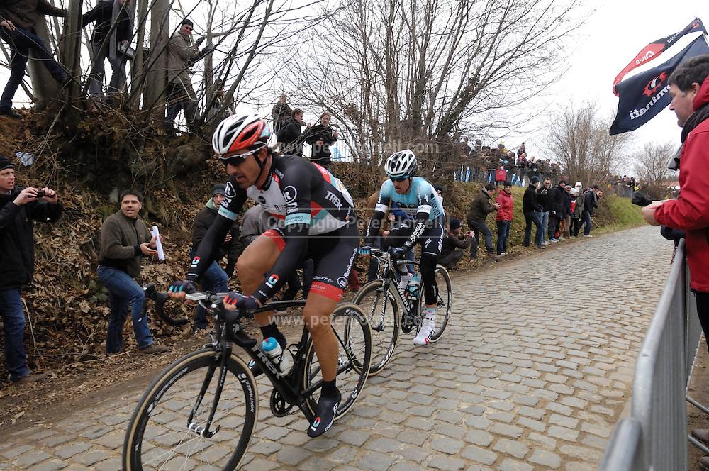 Belgium, March 31 2013: RADIOSHACK-LEOPARD rider, Fabian Cancellara, is followed by Michal Kwiatkowski, OMEGA PHARMA-QUICK STEP, up the final climb of the Oude-Kwaremont during the elite men's Ronde van Vlaandaren 2013. Copyright 2013 Peter Horrell.