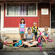 Desarae Mann, 7, rests her head on her mom, April's leg, next to her sister, Ariana Mann, 8, left. Also with the Manns are siblings, Kam'ryn, 5, and Kaliyah Stouffer, 8 in downtown Smithsburg, Maryland, on Tuesday, September 26, 2017. Smithsburg is a very different town than the southern part of the district that includes Potomac and Germantown. Originally a District that was mostly rural, but included big towns like Frederick Hagerstown, along with smaller ones like Smithsburg, Maryland's 6th District was redistricted in 2011, combining rural northern Maryland regions with more affluent communities like near Washington D.C. turning the district from Republican to Democrat. <br /> For The Wall Street Journal