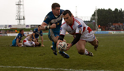 Hull KR's Danny Fitzhenry scores the winning try past Hull FC's Lee Radford during the engage Super League match at Craven Park Stadium, Hull.