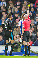 Lee Mason (Referee) awarded a yellow card to Jurgen Locadia (Brighton) with Hal Robson-Kanu (Capt) (West Brom) looking on during the FA Cup fourth round match between Brighton and Hove Albion and West Bromwich Albion at the American Express Community Stadium, Brighton and Hove, England on 26 January 2019.