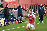 Crawley Town Assistant Coach Lee Bradbury and Crawley Town Head Coach John Yems react after the referee gave a foul against their side during the EFL Sky Bet League 2 match between Cheltenham Town and Crawley Town at Jonny Rocks Stadium, Cheltenham, England on 10 October 2020.