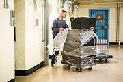 Prisoners unload the weekly canteen supplies on Drake wing, HMP/YOI Portland, a resettlement prison with a capacity for 530 prisoners.