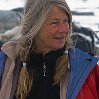 Writer Gretel Ehrlich watches as a reindeer caravan herded by the last nomadic Komi clan loads its sleds on the vast frozen tundra north of the Arctic Circle, near Nizhnyaya Pesha, Russia.