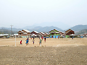 Boys playing football in the recently relocated village of Ban Thong Chalern in Sayaboury province, Lao PDR. Ban Thong Chalern consists of three villages (Khmu and Lao Loum) which have been joined together and relocated due to construction of the Xayaburi dam, a major hydropower project on the Mekong river.
