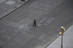 June 13, 2018 - Buenos Aires, Buenos Aires, Argentina - A police officer walks past a graffiti painted on the street in front of the National Congress. The Low House passed a bill allowing legal abortion in Argentina by a tight margin. (Credit Image: © Patricio Murphy via ZUMA Wire)