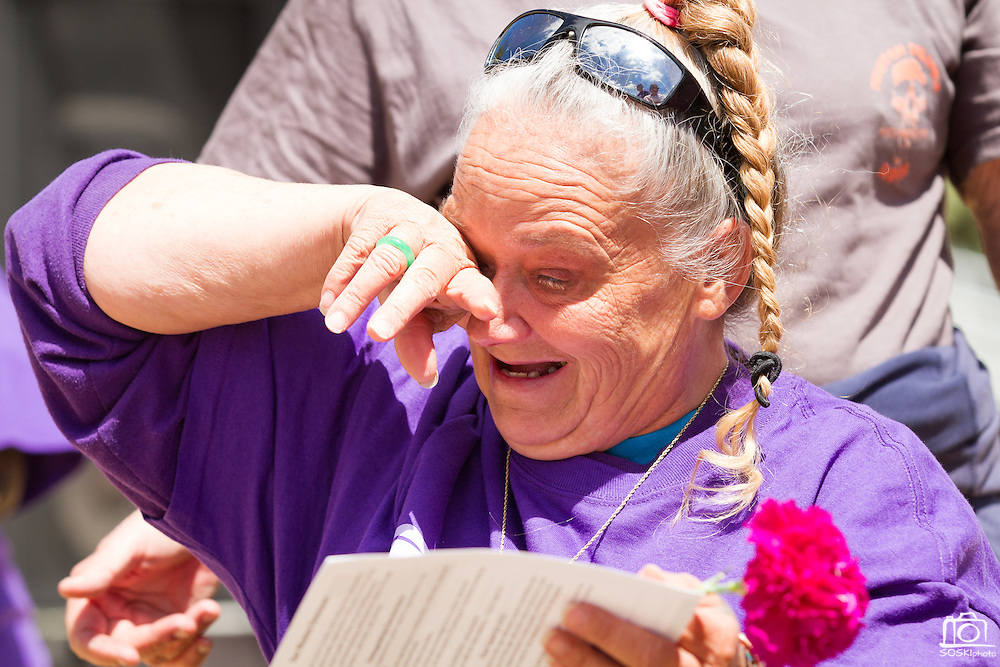 Jennifer Cole, survivor of colon cancer, is overwhelmed with emotion during the opening ceremony of Relay For Life at the Milpitas Sports Center on June 23, 2012.  Photo by Stan Olszewski/SOSKIphoto.