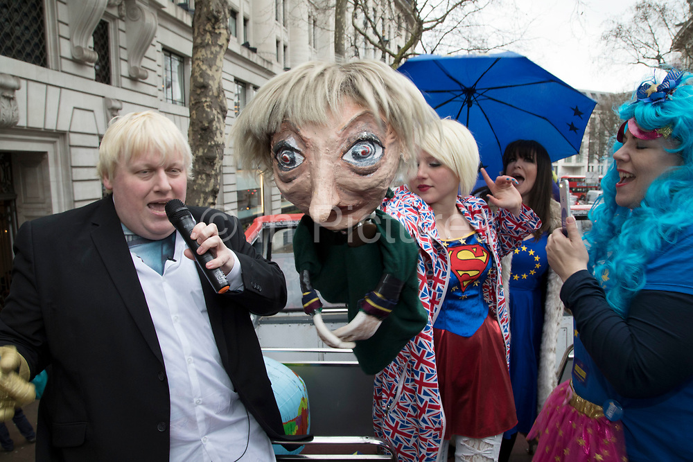 With one year to go until Brexit, anti-Brexit, pro-Europe demonstrators protest including a Boris Johnson lookalike and a Theresa May puppet in favour of staying in the European Union aboard an EU superhero Brexit battle bus on 29th March 2018 in London, England, United Kingdom. As the Tories continue their negotiations with EU leaders, protesters make their views heard throughout the capital.