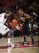 Nov 16, 2011; Fayetteville, AR, USA; Oakland Grizzlies guard Ryan Bass (33) dribbles against Arkansas Razorback guard Mardracus Wade (1) during a game at Bud Walton Arena. Arkansas defeated Oakland 91-68. Mandatory Credit: Beth Hall-US PRESSWIRE