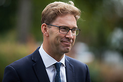 """London, UK. 25 September, 2019. Tobias Ellwood, Conservative MP for Bournemouth East, is interviewed on College Green on the day after the Supreme Court ruled that the Prime Minister's decision to suspend parliament was """"unlawful, void and of no effect"""". Credit: Mark Kerrison/Alamy Live News"""