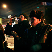Homeless Russian men drink vodka on a street in Moscow several days after the New Year celebrations. .Alcoholism is one of the main causes of death in Russia.