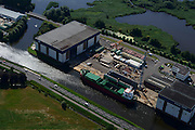 Nederland, Groningen, Gemeente Hoogezand-Sappemeer, 27-08-2013; Westerbroek, Scheepswerf Ferus Smit. Werf voor bouw van zeeschepen met karakteristiek dwarshelling.<br /> Ferus Smit Shipyards. Yard for sea vessels, sideway-launching yard.<br /> luchtfoto (toeslag op standaard tarieven);<br /> aerial photo (additional fee required);<br /> copyright foto/photo Siebe Swart.