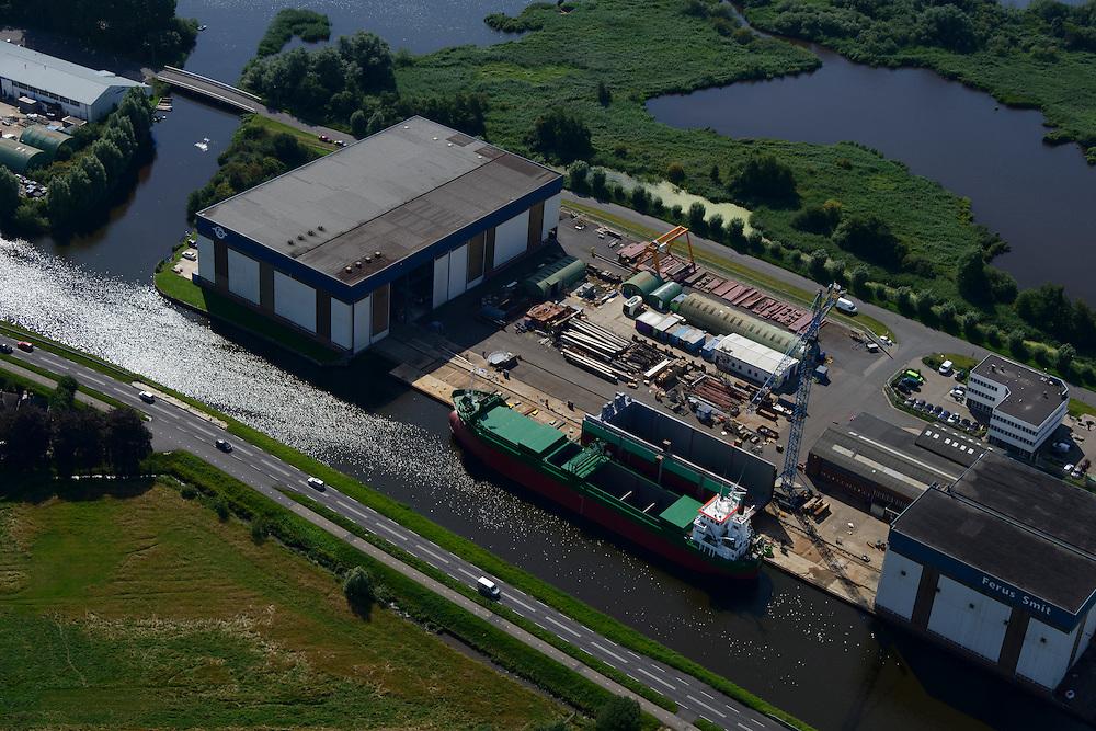 Nederland, Groningen, Gemeente Hoogezand-Sappemeer, 27-08-2013; Westerbroek, Scheepswerf Ferus Smit. Werf voor bouw van zeeschepen met karakteristiek dwarshelling.<br /> Ferus Smit Shipyards. Yard for sea vessels, sideway-launching yard.<br /> luchtfoto (toeslag op standaard tarieven);<br /> aerial photo (additional fee required);<br /> copyright foto/photo Siebe Swart.