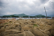 Fishing nets dry on a waste land close the shore. Khanh Hoa area, Vietnam, Asia