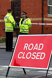 © licensed to London News Pictures. Salford, UK  27/02/2012. Police close off several streets in Claremont, Salford after two men were shot and blood was found in the street. Photo credit should read Joel Goodman/LNP