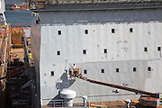 RFA Mounts Bay ship in dry dock being painted, Falmouth, Cornwall, England, UK