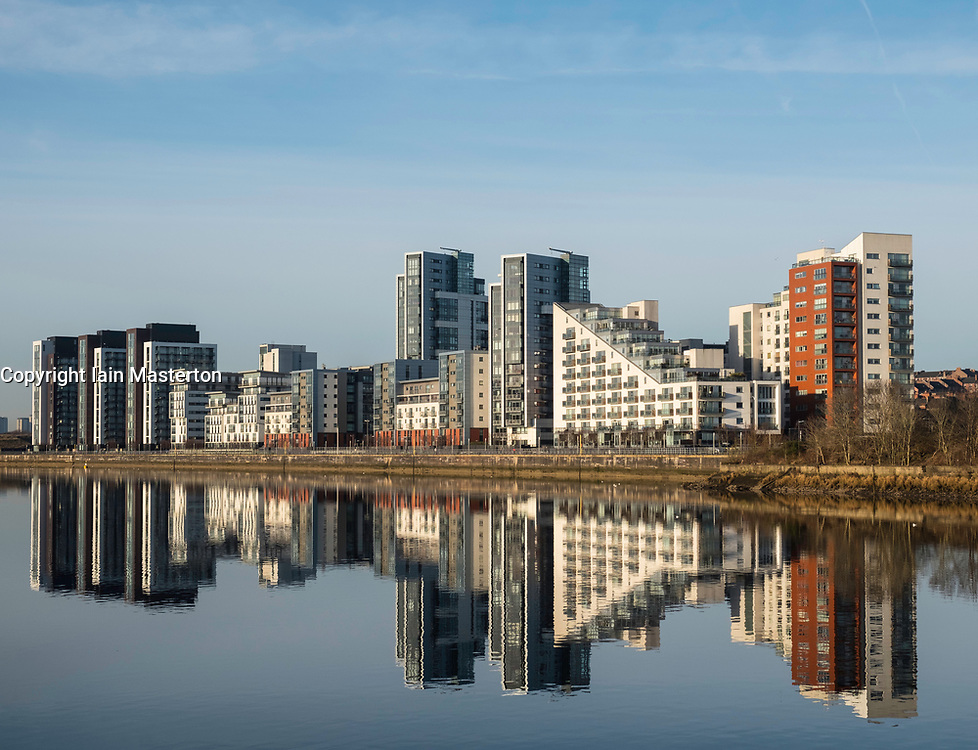 View of Glasgow Harbour modern property development with many high-rise modern riverside apartment buildings in Glasgow, United Kingdom