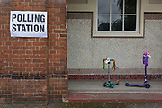 Childrens scooters left outside their local polling station on the morning of the UK 2017 general elections outside St. Saviours Parish Hall in Herne Hill, Lambeth, on 8th June 2017, in London, England.