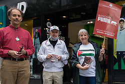 Pro-Palestinian activists canvass support from the public outside a branch of JD Sports during a Boycott Puma day of action on 10th July 2021 in Slough, United Kingdom. The nationwide day of action was organised by Palestine Solidarity Campaign in protest against Puma's sponsorship of the Israeli Football Association, which includes clubs playing in Israeli settlements in the occupied West Bank, and in response to a call from Palestinians to mark the 16th birthday this week of the Boycott, Divestment and Sanctions (BDS) movement.
