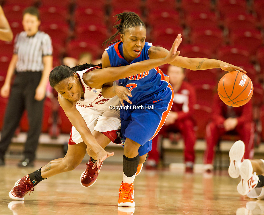 Jan 29, 2012; Fayetteville, AR, USA; Arkansas Razorbacks forward Ashley Daniels (12 ) attempts to gain control of a ball against Florida Gators guard Lanita Bartley (3) during a game at Bud Walton Arena. Arkansas defeated Florida 73-72 in the second overtime. Mandatory Credit: Beth Hall-US PRESSWIRE
