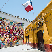A large painted mural on a building wall near the Mercado Central in downtown Chile de Santiago.