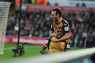 Joel Campbell of Arsenal gets a squeeze and headlock as he celebrates with Santi Cazorla (top) after he scores his teams 3rd goal. Barclays Premier league match, Swansea city v Arsenal  at the Liberty Stadium in Swansea, South Wales  on Saturday 31st October 2015.<br /> pic by  Andrew Orchard, Andrew Orchard sports photography.