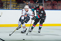 KELOWNA, CANADA - SEPTEMBER 5: Quinn Benjafield #22 of the Kamloops Blazers passes the puck away from Erik Gardiner #12 of the Kelowna Rockets on September 5, 2017 at Prospera Place in Kelowna, British Columbia, Canada.  (Photo by Marissa Baecker/Shoot the Breeze)  *** Local Caption ***