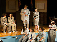 "Matthew Harrison Brady (Taylor Gagne) and E.K. Hornbeck (Ashley Neylon) surrounded by members of the cast of ""Inherit The Wind"" during dress rehearsal Wednesday afternoon at Laconia High School.  (Karen Bobotas/for the Laconia Daily Sun)"