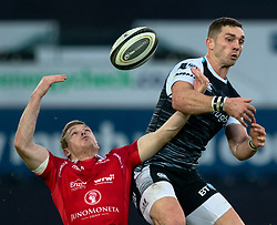 Johnny McNicholl of Scarlets and George North of Ospreys vie for the high ball<br /> <br /> Photographer Simon King/Replay Images<br /> <br /> Guinness PRO14 Round 11 - Ospreys v Scarlets - Saturday 22nd December 2018 - Liberty Stadium - Swansea<br /> <br /> World Copyright © Replay Images . All rights reserved. info@replayimages.co.uk - http://replayimages.co.uk