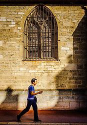 A man walks past the Notre Dame church in Beaune, Burgundy, France<br /> <br /> (c) Andrew Wilson   Edinburgh Elite media