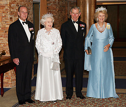 File photo dated 23/11/07 of Queen Elizabeth II, The Duke of Edinburgh, The Prince of Wales and The Duchess of Cornwall at The Queen's Banquet for the Commonwealth's Heads of Government in Kampala, Uganda. The Duke of Edinburgh has died, Buckingham Palace has announced. Issue date: Friday April 9, 2020.. See PA story DEATH Philip. Photo credit should read: Ian Jones/PA Wire
