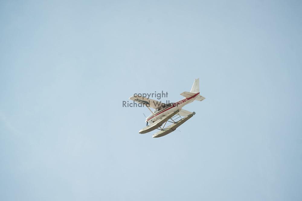 2017 SEPTEMBER 22 - A seaplane flies over the South Lake Union area, Seattle, WA, USA. By Richard Walker