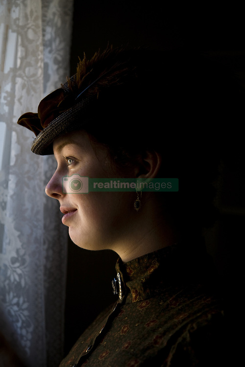 July 21, 2019 - Woman In Vintage Clothes Looking Through Window (Credit Image: © Richard Wear/Design Pics via ZUMA Wire)