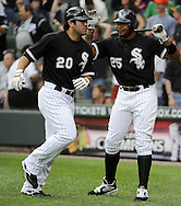 CHICAGO - JULY 10:  Carlos Quentin #20 is greeted by Andruw Jones #25 of the Chicago White Sox after Quentin hit the first of his two home runs in the second inning against the Kansas City Royals on July 10, 2010 at U.S. Cellular Field in Chicago, Illinois.  The White Sox defeated the Royals 5-1.  (Photo by Ron Vesely)