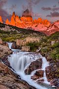 FitzRoy waterfall at dawn under famous rock peak Cerro FitzRoy ( El Chalten) , Parque Nacional Los Glaciares, Patagonia, Argentina