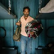 Peddler selling Sarees.<br /> Life on the longest train ride in India, between Kanyakumari and Dibrugarh city.