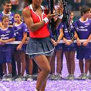 Serena Williams of the U.S. celebrates with the trophy after her victory against Russia's Maria Sharapova after their final WTA tennis championships match in Istanbul, October 28, 2012.  Photo by TURKPIX