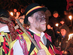 Wath Morris Men Danceoutside Wath Parish Church before the  prosession to Wath Town Square on Sunday Night as part of the Wath Fire Festival<br /><br />Sunday23-12-2001