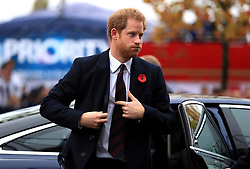 Prince Harry arrives ahead of the Autumn International match at Twickenham Stadium, London.
