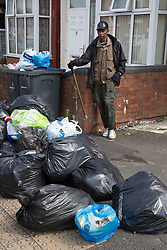 © Licensed to London News Pictures. 25/07/2017. Birmingham, UK. The strike by Birmingham bin men continues as piles of rubbish in certain areas goes uncollected.<br /> Jamil Maeem who has lived in Nansen Road, Alum Rock for forty years is finding people from nearby streets are dumping their uncollected waste outside his house.  Photo credit: Dave Warren/LNP