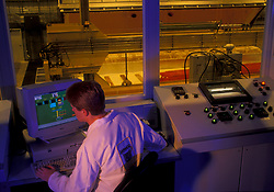 Stock photo of a man operating the computer in a laboratory control room