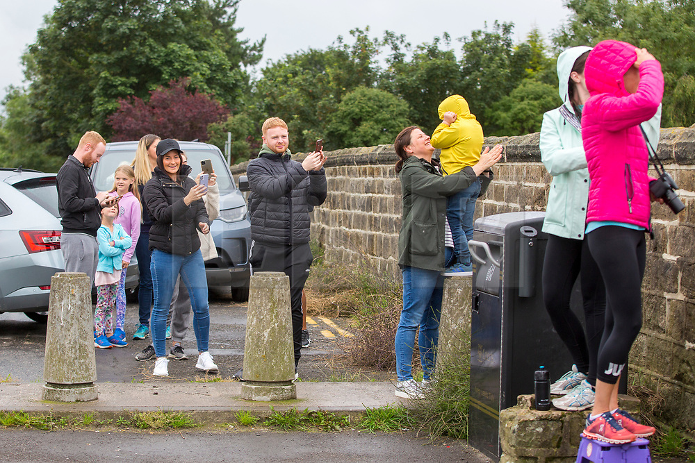 © Licensed to London News Pictures. 15/07/2020. Leeds UK. A small crowd of people watch as Jet2 flight LS257 to Palma departed from Leeds Bradford Airport this morning making it the first Jet2 flight since the airline stopped all flights in April due to the Covid-19 outbreak. Photo credit: Andrew McCaren/LNP