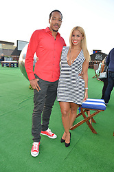 SHANIE RYAN and TONY SINCLAIR at the launch of the Orangina Boulers Rooftop Petanque held on the top floor of the Stratford Multistorey Car Park, Great Eastern Way, London E15 on 26th August 2015.