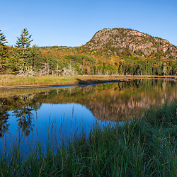 """""""The Beehive"""" reflects in a tidal creek in Maine's Acadia National Park."""
